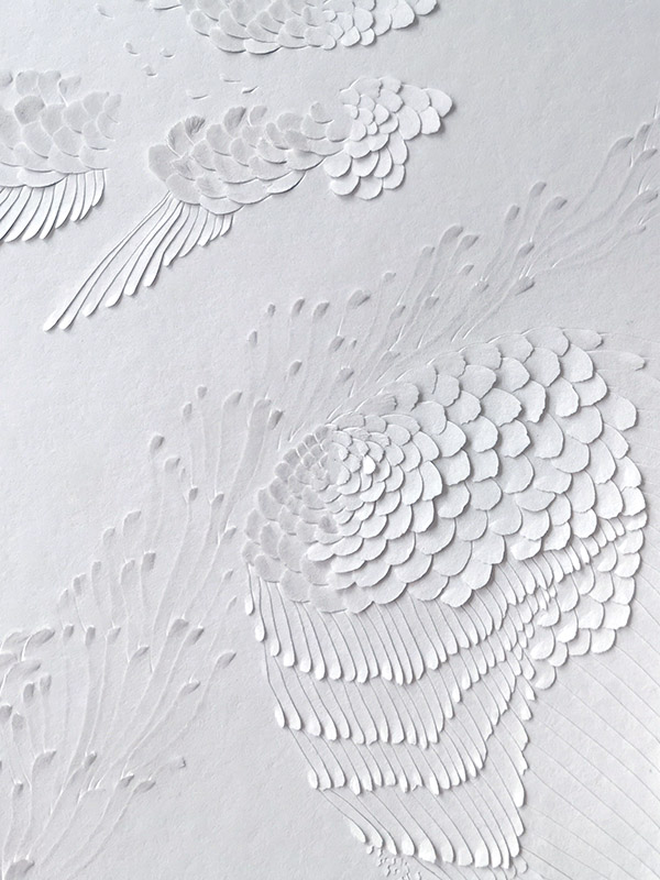 Hong Kong artist Dana Shek creates a paper cut artwork of wings and flowers.