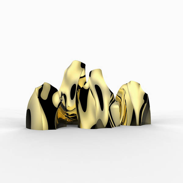 Modern gold sculptures inspired by mountains.