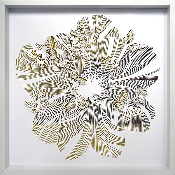 Paper work of a flower surrounded by butterflies.