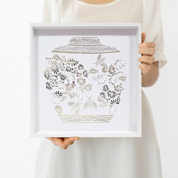 Paper artist Dana Shek's paper cut art of leaves and bees.