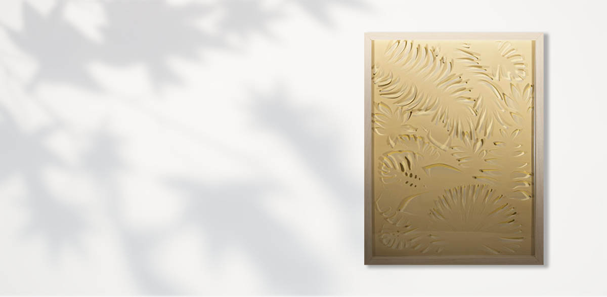 Floral paper cutting art in gold with transparent paper.