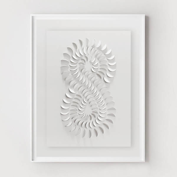 Modern paper cut and folded art on white paper by Urban Impressions.