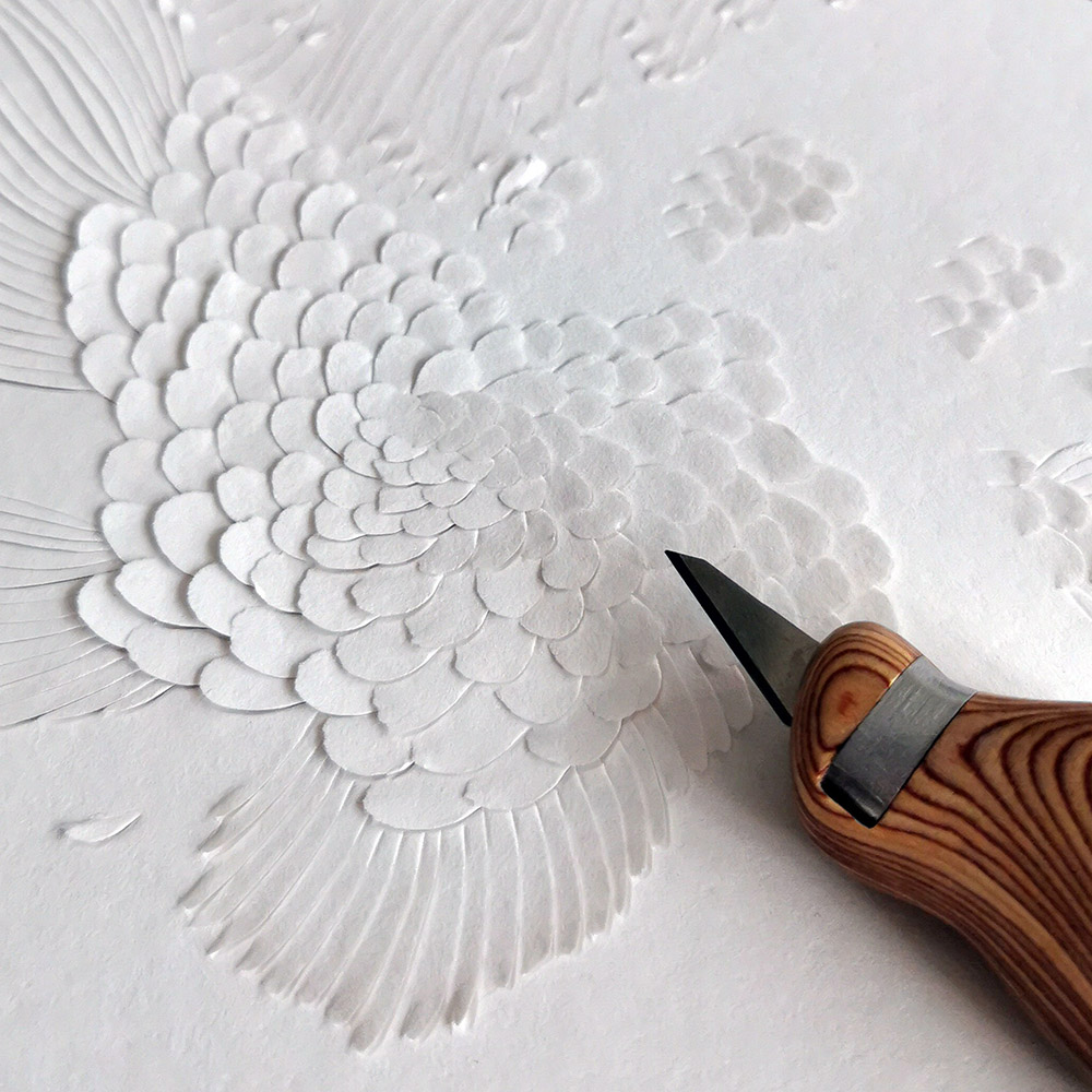 Paperccutting of flowers and feathers by Hong Kong artist Dana Shek.