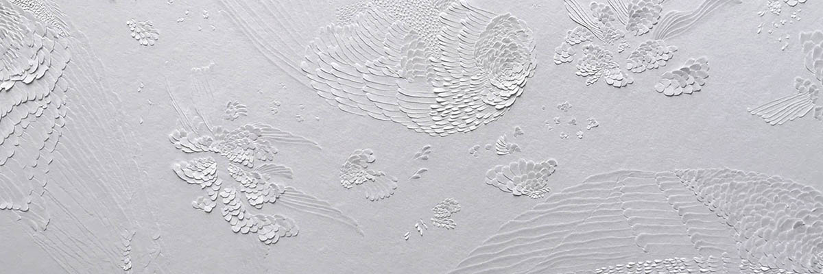 Paper cut art of feathers and flowers by British artist Dana Shek.